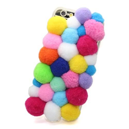 case met kleurige bolletjes